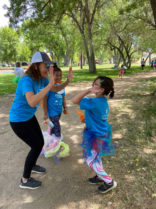 Barbara cheers on La Tierra girls during Girls on the Run